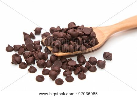 Chocolate Chips In Wooden Spoon On White Background