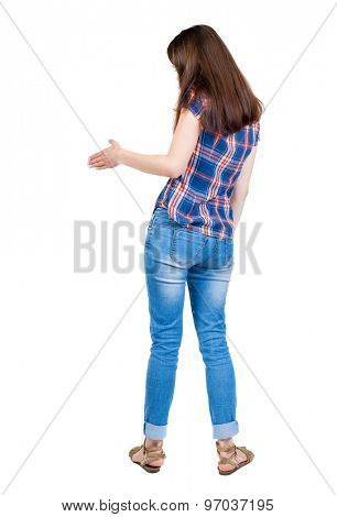 back view of woman shake hands. Rear view people collection. backside view of person.  A young girl in a checkered blue with red stripes stretches right hand for a handshake.