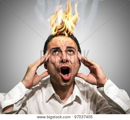 Man having his braing burning up due to stress