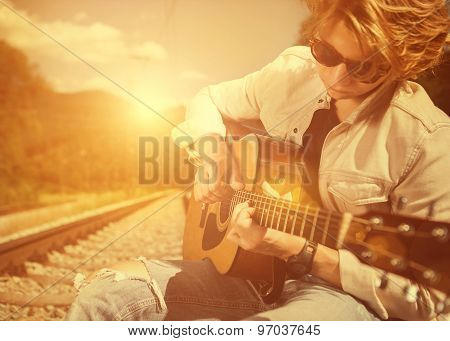 Guy With Guitar On The Railway