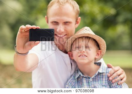 Father With Son Take Self Photo