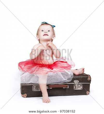 Little Girl In Tutu Skirt Sitting On The Retro Suitcase