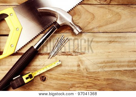 Assortment of tools on wood