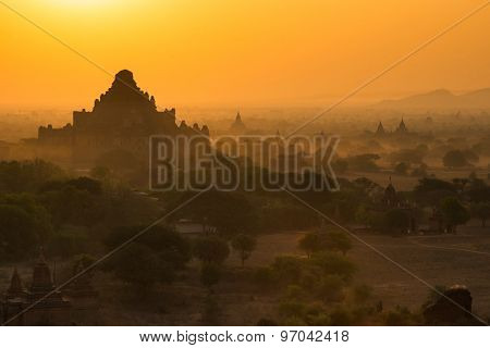 Balloons fly over thousand of temples in sunrise in Bagan, Myanmar