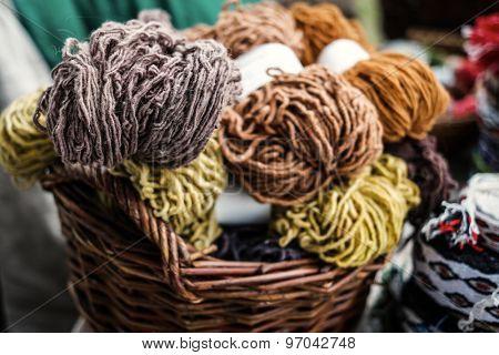 colorful woolen yarn in wooden baskets