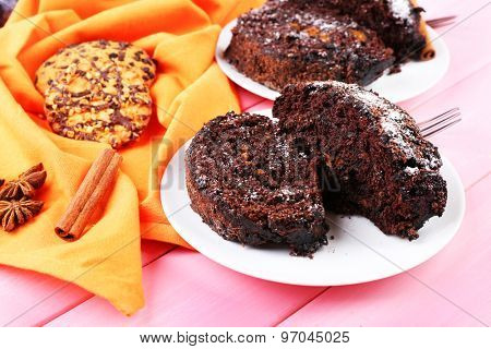 Delicious chocolate roll on wooden table with orange napkin ,closeup
