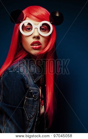 Beautiful woman with red hair wearing big sunglasses