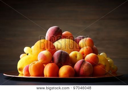 Heap of fresh fruits on dark background