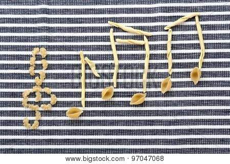 Treble clef and musical notes of pasta on striped background