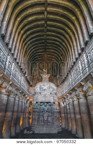 AJANTA, INDIA - 14 JANUARY 2015: Chaitya-griha or prayer hall in Cave 26. Part of 29 rock-cut Buddhist cave monuments at Ajanta Caves. Part of UNESCO World Heritage Site.