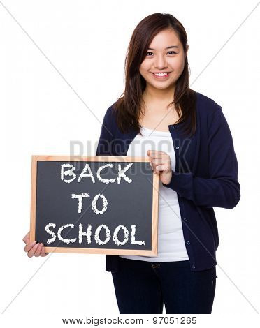 Woman showing the chalkboard with phrase of back to school