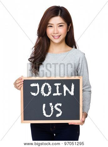 School girl hold with chalkboard and showing phrase join us