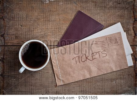 Tickets In Envelope, Passport And Coffee