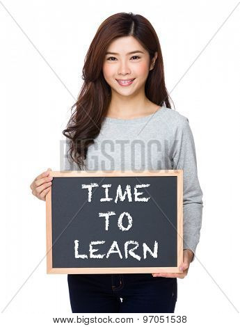 School girl hold with chalkboard and showing phrase of time to learn