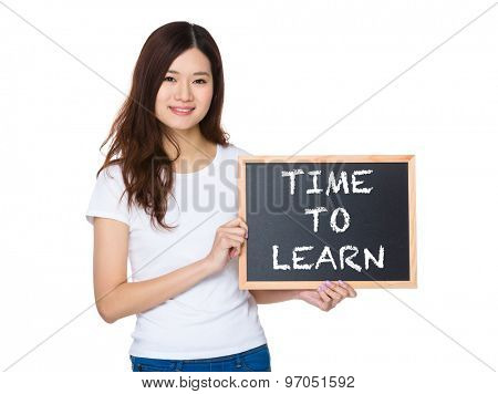 Woman with the chalkboard showing phrase of time to learn