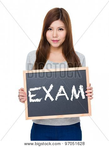 Asian woman hold with blackboard showing a word exam