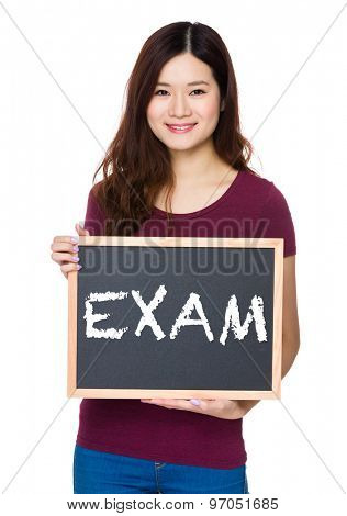 Asian Young woman hold with chalkboard and showing a word exam