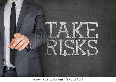 Take risks on blackboard with businessman