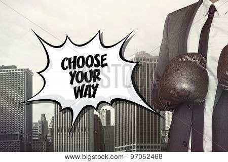 Choose your way text with businessman wearing boxing gloves