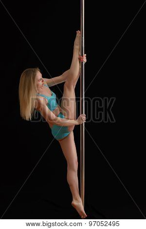 Young slim pole dance woman exercising