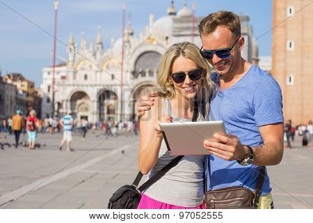 Tourists using tablet computer while sightseeing in Venice