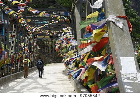 Annapurna, Nepal-May 10,2015: the travelers are walking through bridge to Poon Hill Nepal