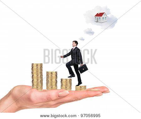 Business man climbing on coins ladder