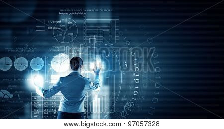 Back view of businesswoman working with modern virtual technologies
