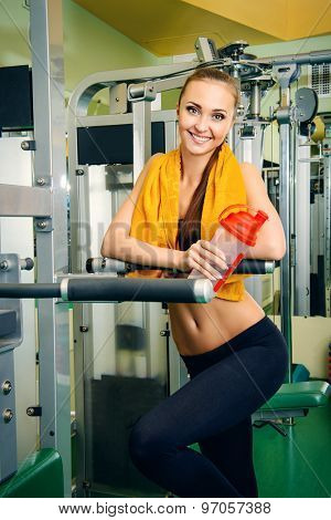 Beautiful slender young woman is training at the gym. Active lifestyle, bodycare. Fitness equipment.