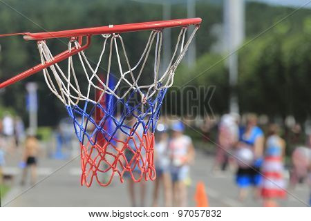 Basketball Hoop For Games And Rides In The City Park On The Background Of People
