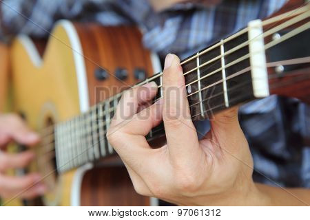 Close up to the hand of guitar player