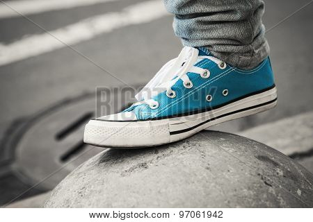 Blue Sneaker, Teenager Foot In Urban Environment