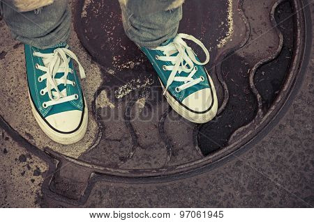 Teenager In Sneakers. Feet In Gumshoes, Old Style