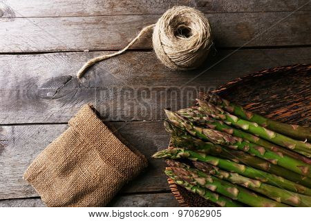 Fresh asparagus on wooden table, top view