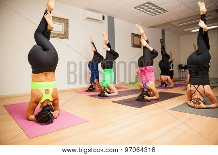 Yoga Instructor And Students In Class