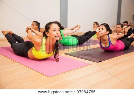 Locust Pose In A Yoga Studio