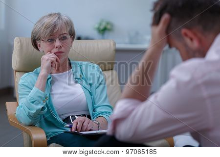 Professional Therapist Listening To Patient
