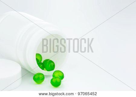 Green Gel Pills An Pill Bottle On White Background