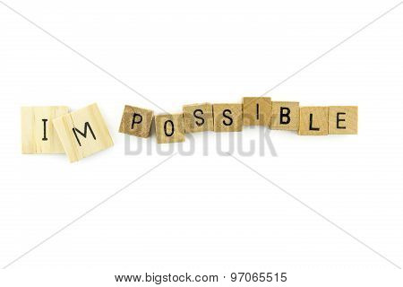 Impossible Text On Wooden Cubes, Isolated On White Background