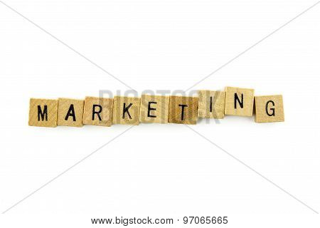Marketing Text On Wooden Cubes, Isolated On White Background