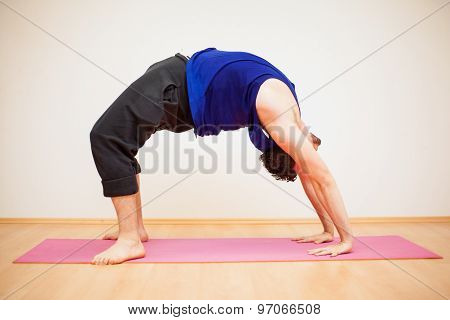 Backbend Pose By A Young Man
