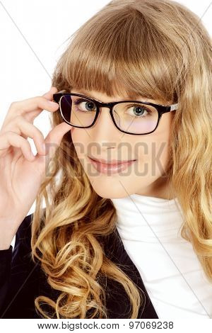 Close-up portrait of a pretty teenager girl in elegant glasses. Optics. Beauty, fashion. Education. Isolated over white.