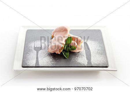 Cream Dessert Eclair on Black Plate