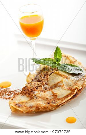 Pancake with Apple and Nuts. Garnished with Buckthorn Sauce