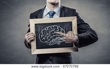 Close up of man holding chalkboard with ideas