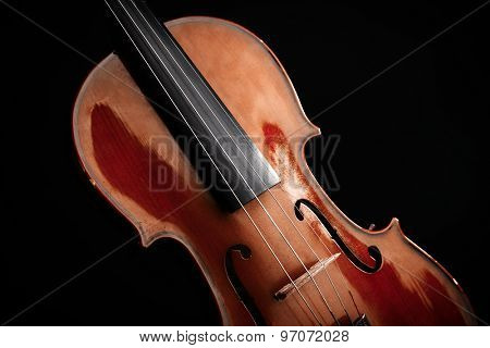 Classical violin on dark background