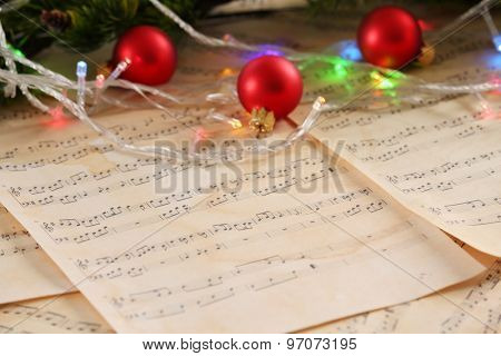 Christmas decorations on music sheets, closeup