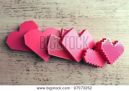 Plastic hearts on wooden background