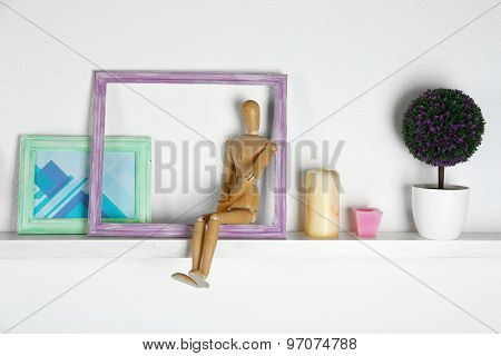 Wooden shelf with decorative things in room