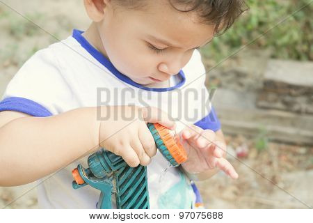 Boy Playing With Garden Hose